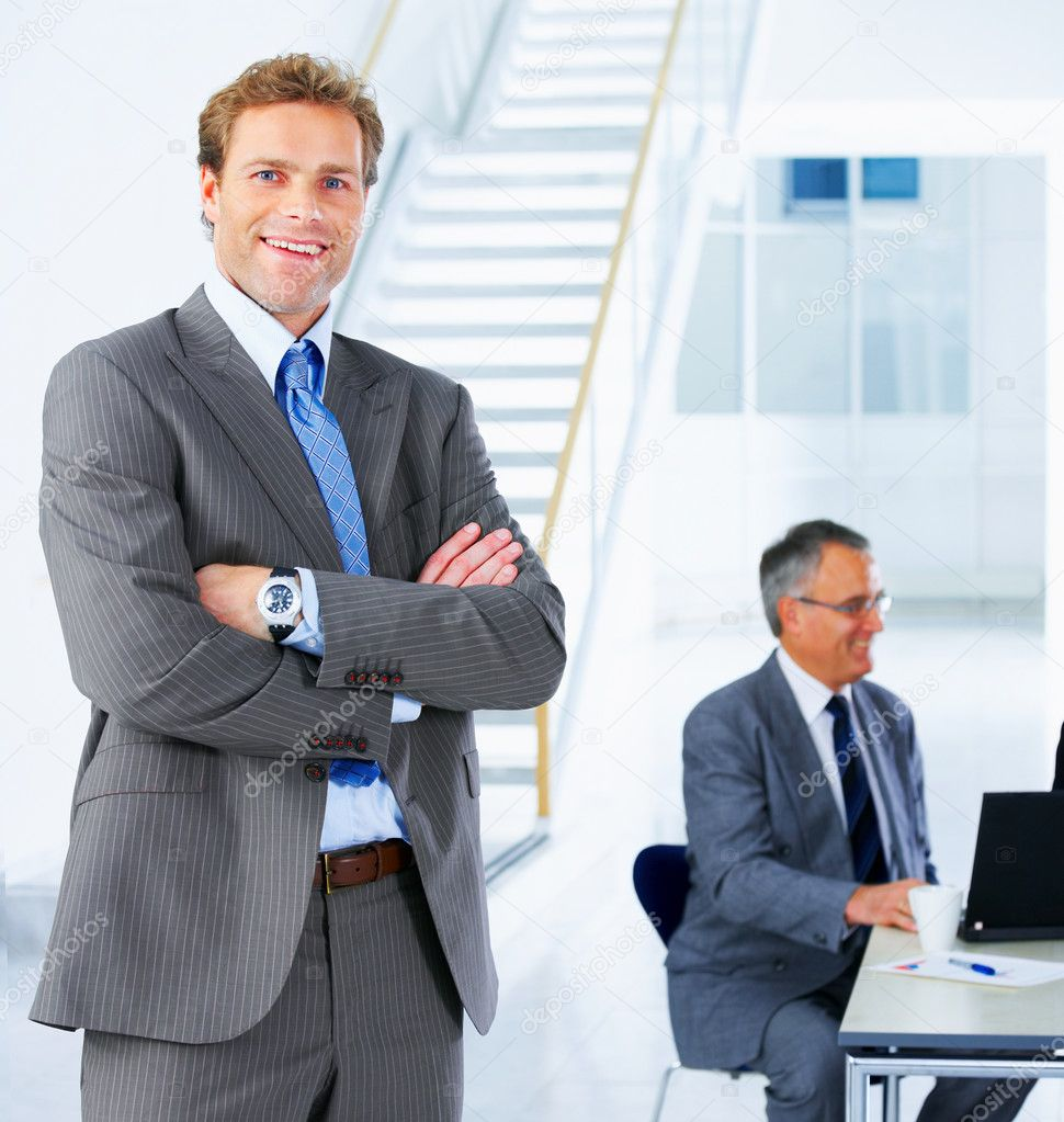 Young business executive - Mature business man with his colleagues in the background — Stock Photo #3220567