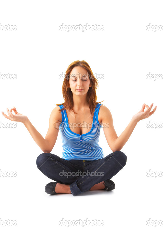 A young beautiful girl meditating in lotus position. Relaxed, and focused on her inner peace. Unique Keyword for this collection is: meditation123 — Stock Photo #3221487