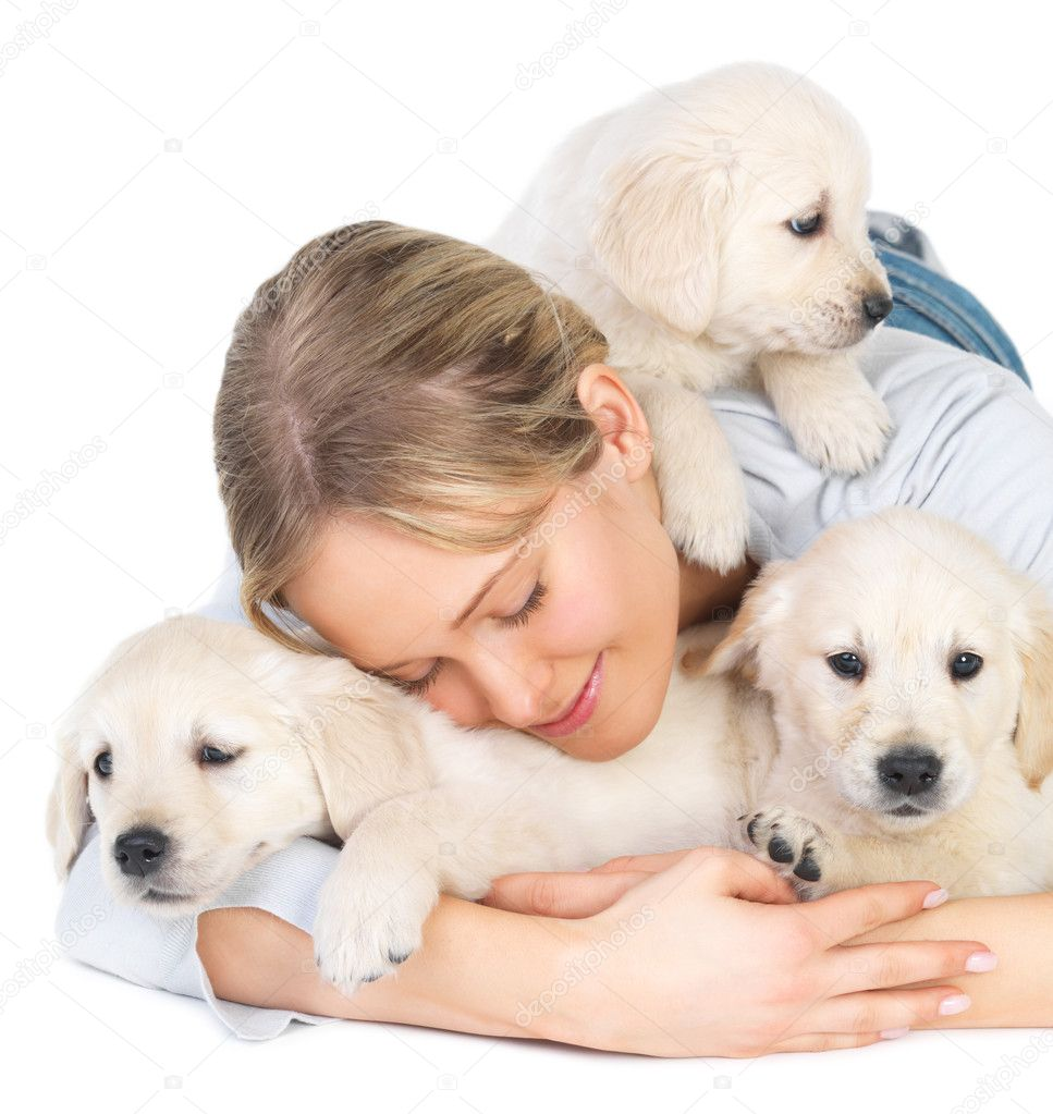 Cute puppies and young girl hugging - Caucasian young female lying on floor with her pet dogs — Stock Photo #3222816
