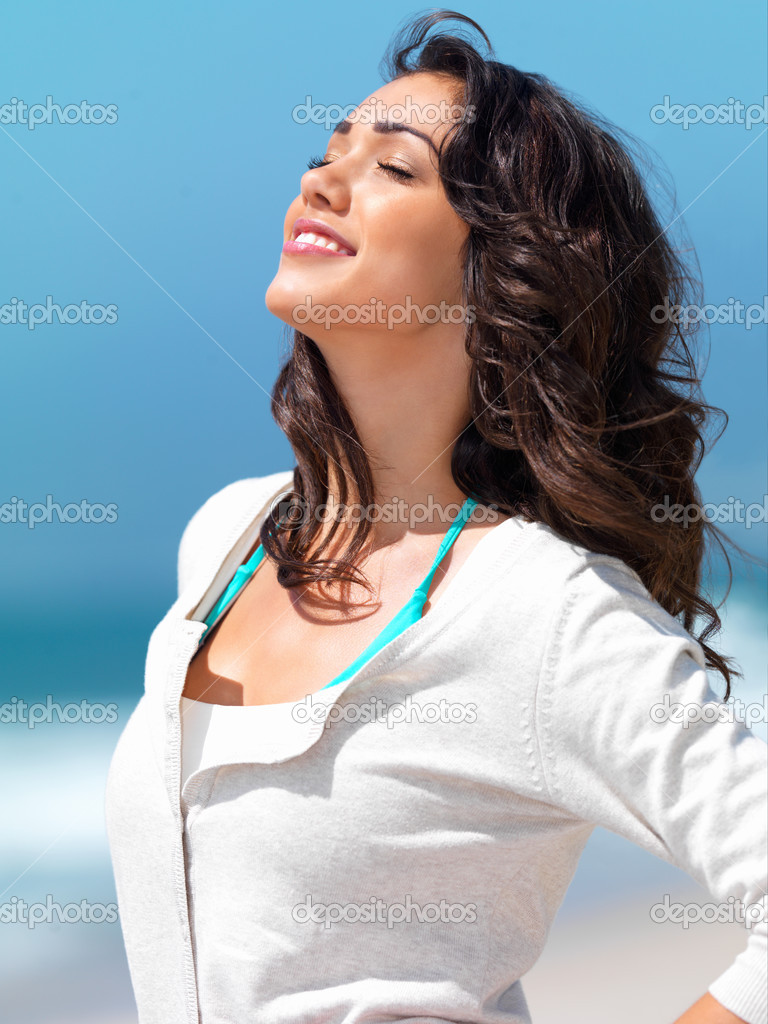 Close up of a smiling young woman with eyes closed — Stock Photo #3225193