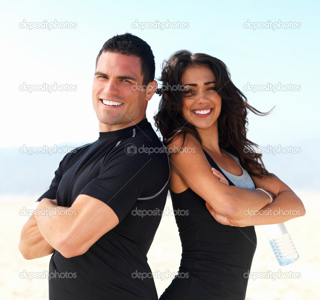 Portrait of a smiling young fitness couple or personal trainers — Zdjęcie stockowe #3225400