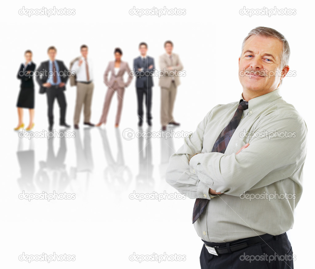 Happy senior business man standing in front of his business team — Stock Photo #3227278