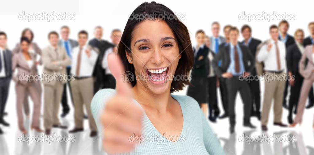 Girl Giving a thumbs up sign with a big smile, business group at the back — Stock Photo #3227291