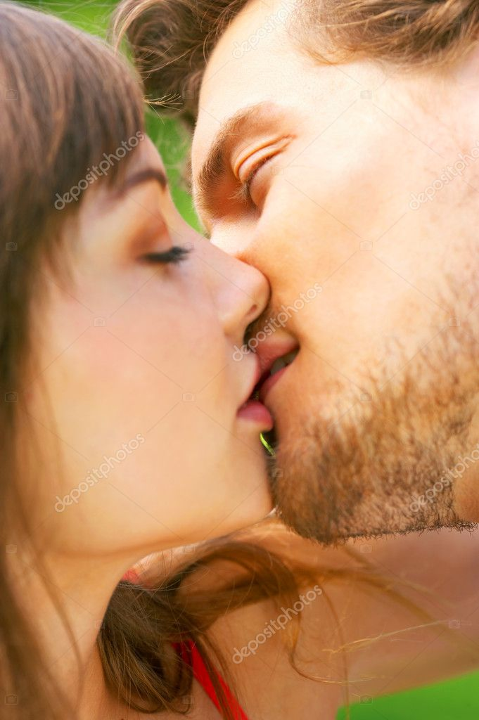 An attractive couple staring into each others eyes as they are about to kiss — Stock Photo #3227529