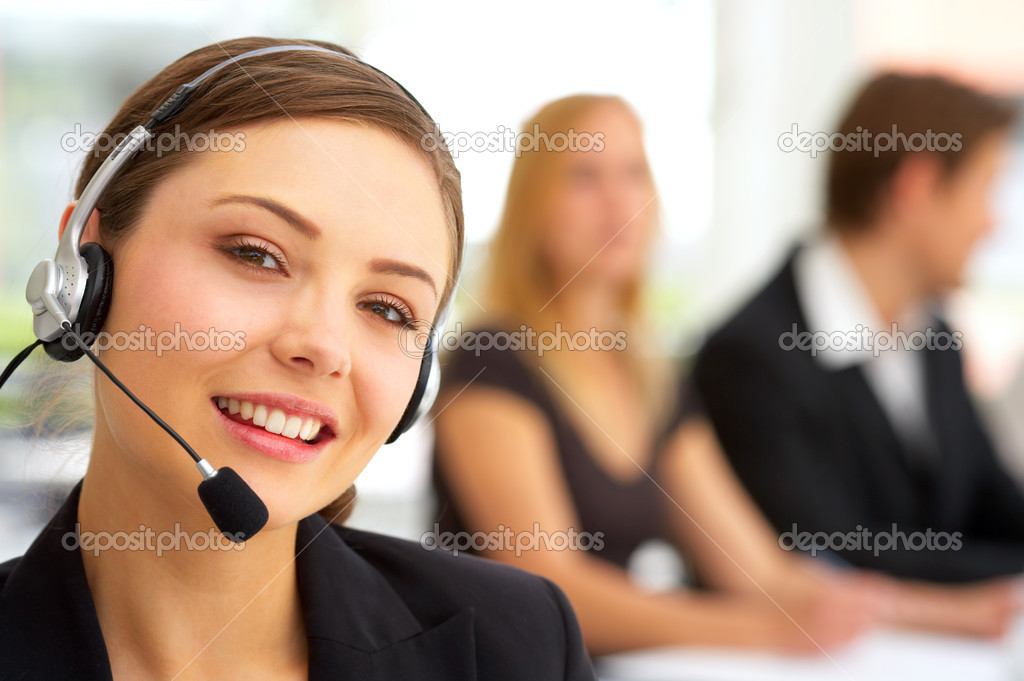 A friendly secretary/telephone operator in an office environment. — Stock Photo #3228586