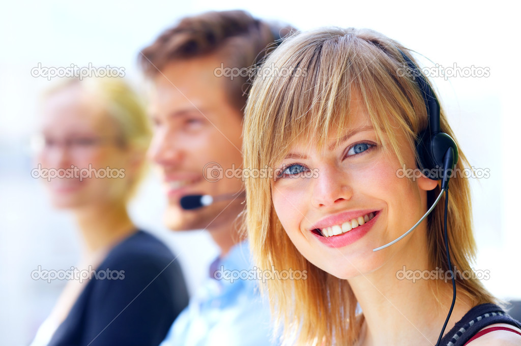 A friendly secretary/telephone operator in an office environment. — Stock Photo #3228794