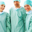 Portrait of a medical team laughing - Stock Photo