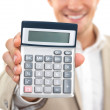 Royalty-Free Stock Photo: Businessman holding calculator