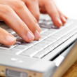 Royalty-Free Stock Photo: Mans hands typing on a laptop