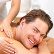 Royalty-Free Stock Photo: Happy young man getting back massage