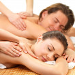 Portrait of a couple getting a romantic massage - Stockfoto