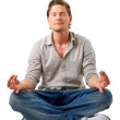 Young handsome man meditating - Stock Photo