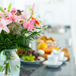 Flowers on breakfast table.