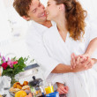 Young couple in their kitchen - Stock Photo