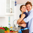 Young couple in their kitchen - Foto de Stock  
