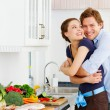 Royalty-Free Stock Photo: Young couple in their kitchen