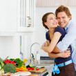 Young couple in their kitchen - Photo