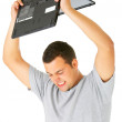 Royalty-Free Stock Photo: Breaking the laptop!