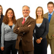 Royalty-Free Stock Photo: Senior Businessman in front of younger employees