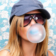 Royalty-Free Stock Photo: Closeup of a young girl blowing bubble gum