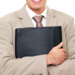 Royalty-Free Stock Photo: Close up portrait of a business man torso, hands holding folder.