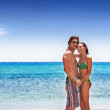 Carefree couple on the beach - Stock Photo