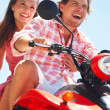Couple on a quadbike - Stock Photo