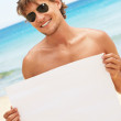 Royalty-Free Stock Photo: At the beach with a poster