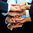 Multi-ethnic pile of hands - Stock Photo