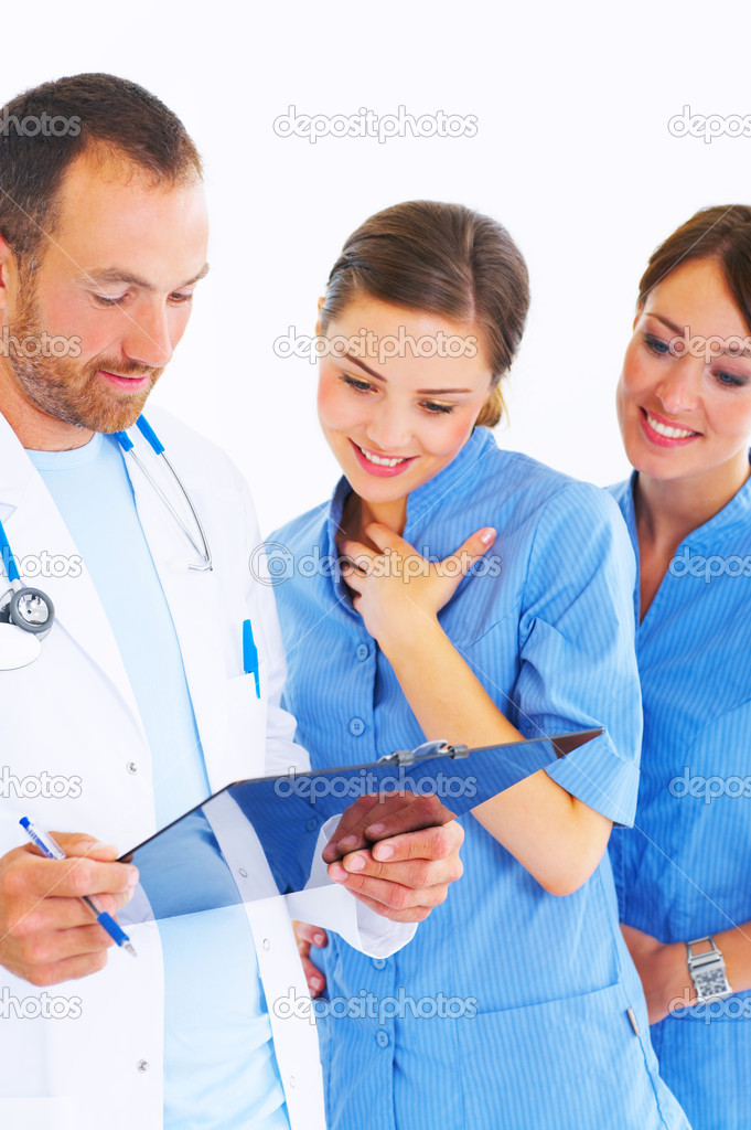 Portrait of doctor consulting with two beautiful nurses. — Stock Photo #3232068
