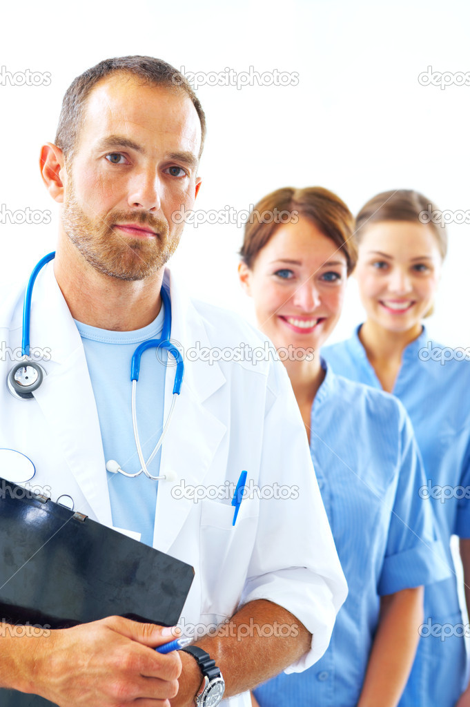 A portrait of doctor with two attractive nurses in the background — Stock Photo #3232186