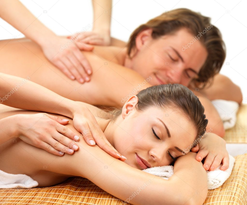 Close up portrait of a romantic couple, on a spa holiday, having a back massage — Stockfoto #3233306