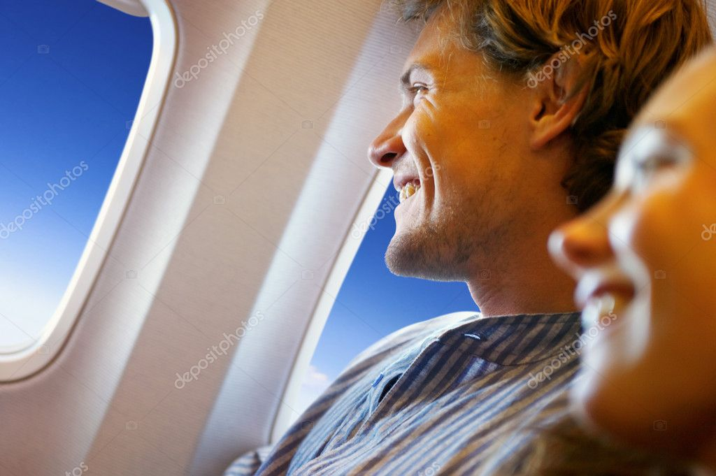 A couple leaving on a jet plane  Stock Photo #3233385