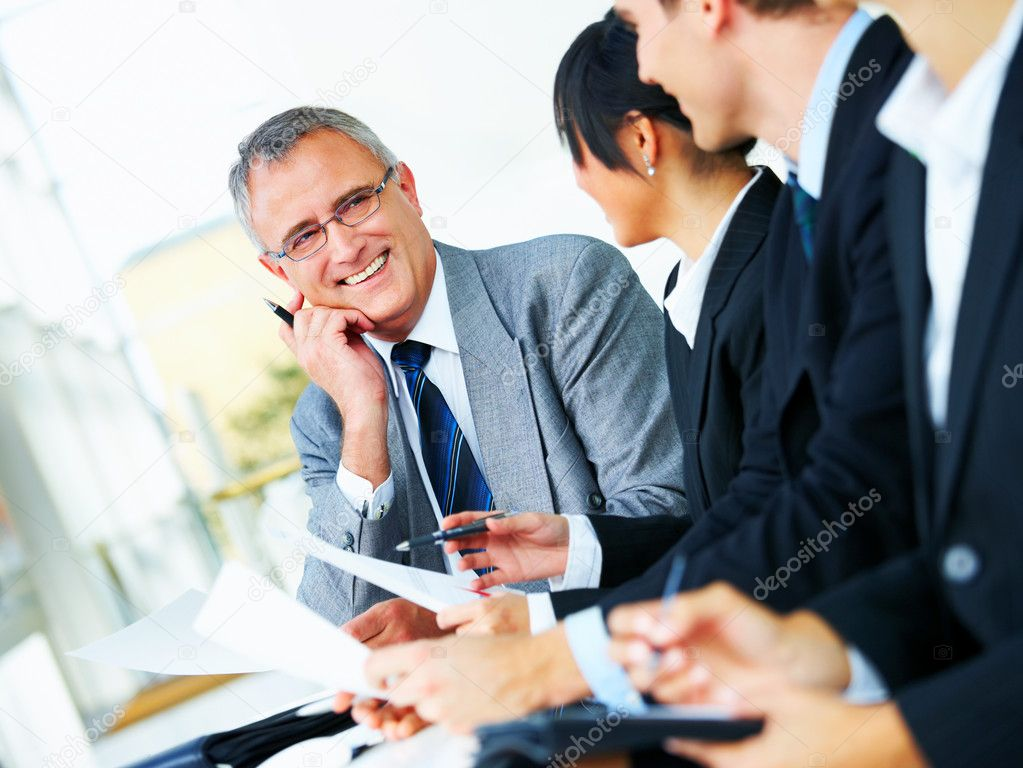 Diverse business group meeting in a light and modern office building  Stock Photo #3236618