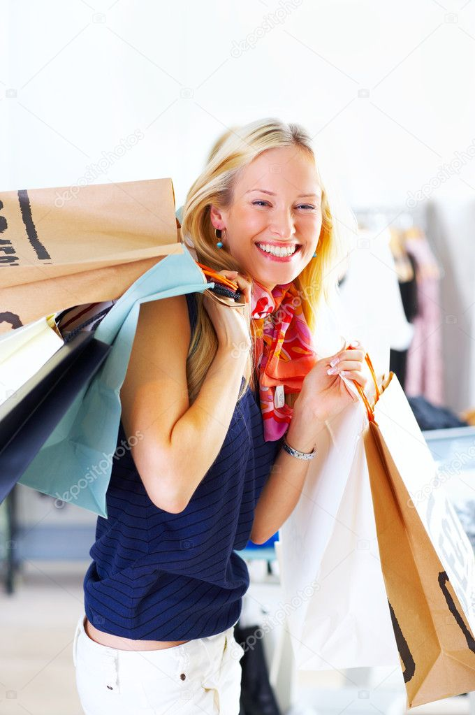 An attractive young lady out shopping.  Stock Photo #3236939