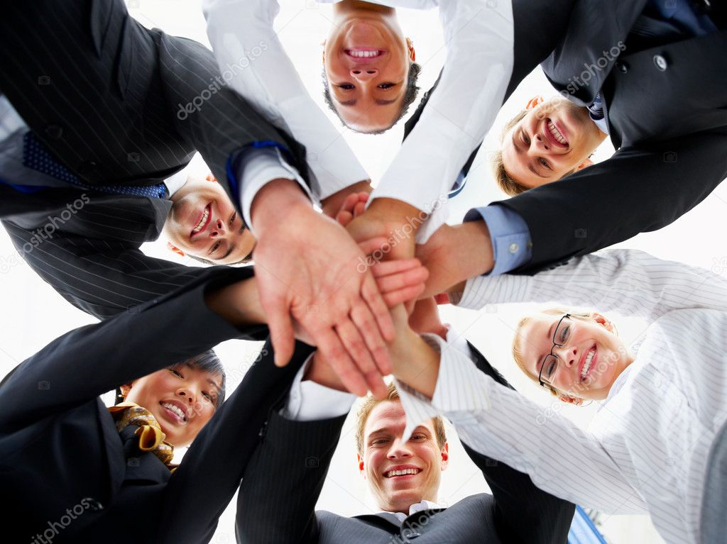 Teamwork and team spirit - Hands piled on top of one another .  Stock Photo #3237149
