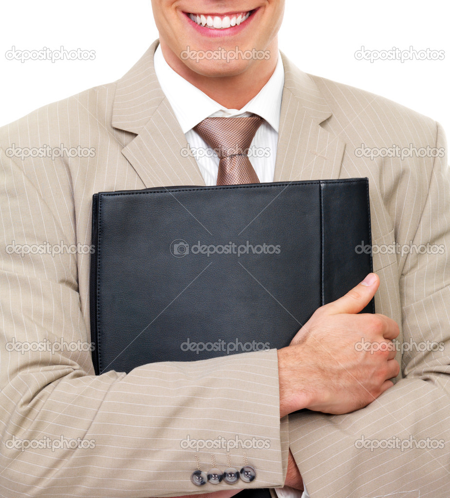 Close up portrait of a business man torso, hands holding folder close into body. Happy smile seen at top. — Stock Photo #3237371