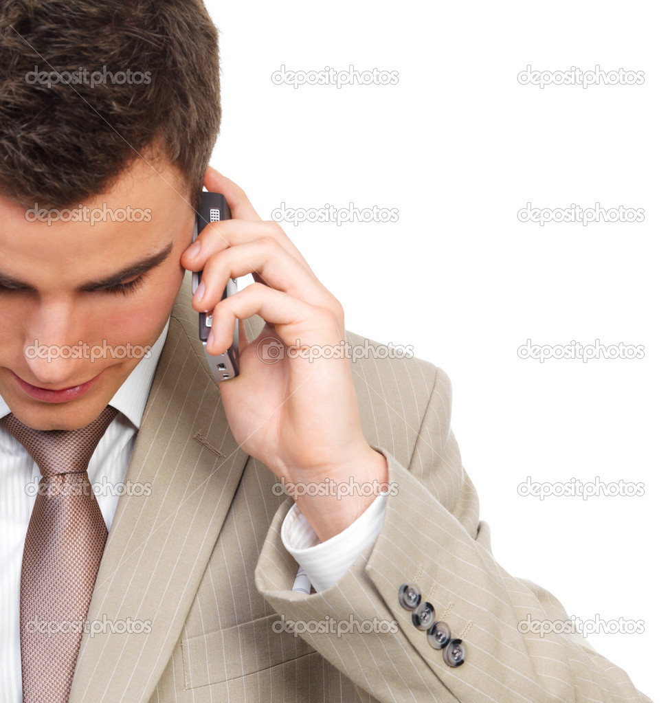 Portrait of handsome young business man talking on cellphone, looking down. Isolated against white background — Stock Photo #3237382