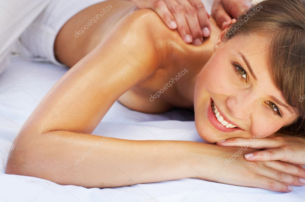 Close-up of a beautiful young woman getting a massage — Stock Photo #3237776
