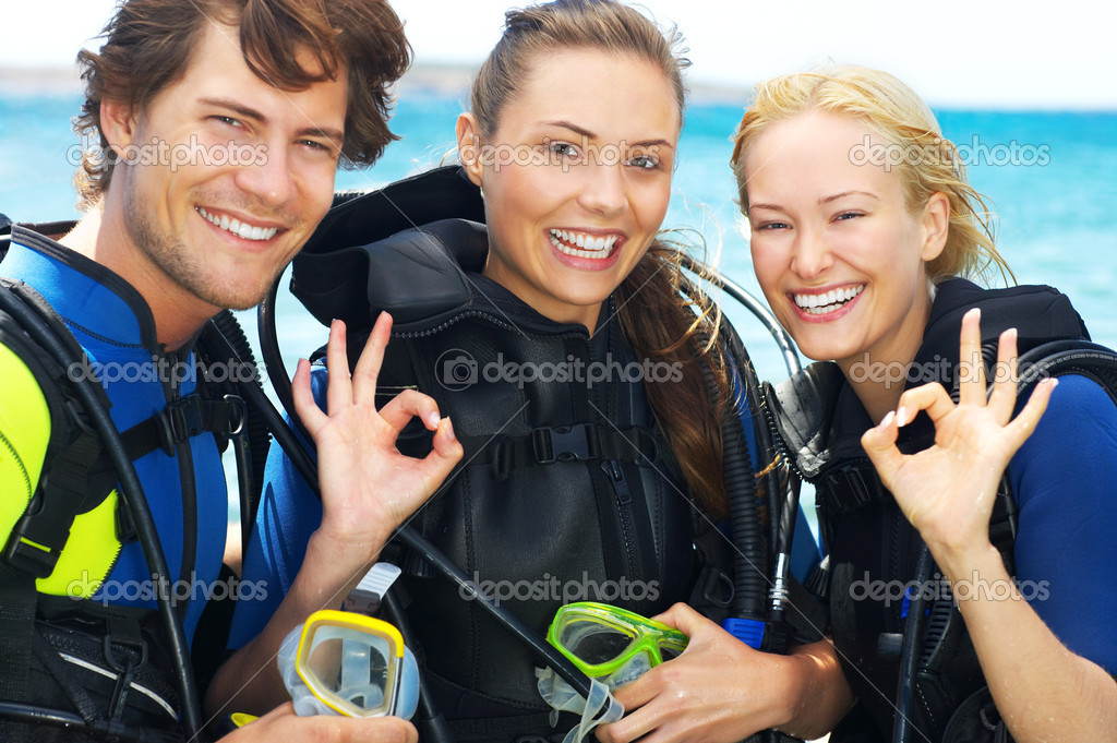 Portrait of three attractive friends going scuba diving  Stock Photo #3238676