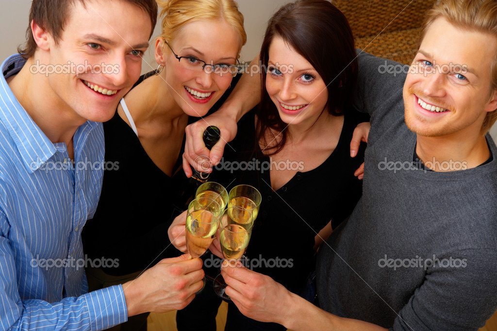 Friends enjoying a celebratory drink of champagne — Stock Photo #3239268