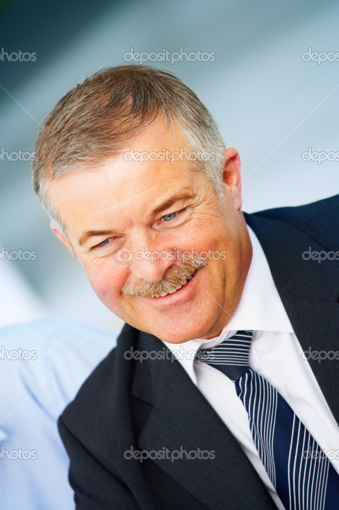 Cheerful senior business man in an office environment — Stock Photo #3239922