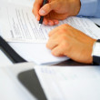 Businessman doing paperwork - Foto Stock