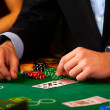 Royalty-Free Stock Photo: Dealer handling cards at a casino