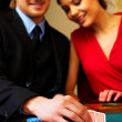 Playing poker in the casino - Stock Photo
