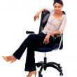 Smiling woman sitting in a chair - Foto Stock