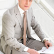 Young business man with paperwork - Stock Photo