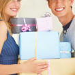 Royalty-Free Stock Photo: Young couples holding gifts