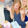 Royalty-Free Stock Photo: Young friends looking at gifts