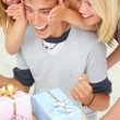 Royalty-Free Stock Photo: Young boys and girls looking at presents